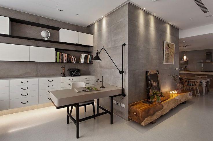 salon cosy de design industriel, béton ciré sol et plafond, parement mural en béton banché et bureau design