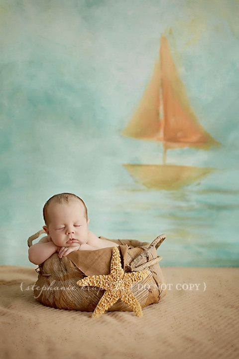 Having a theme tying in where the baby is with the background adds more interest to a plain newborn shot