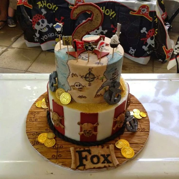 Fox's 2nd Pirate Birthday Party 2 Tier Pirate Cake. Treasure Map Rope Twist Red White Stripe Skulls Gold Coins Name Scroll.