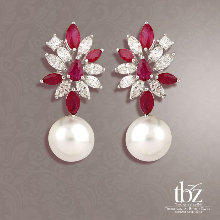 Spoil yourself in these Earrings with the trinity of suave diamonds and rubies with the immortal pearls.
