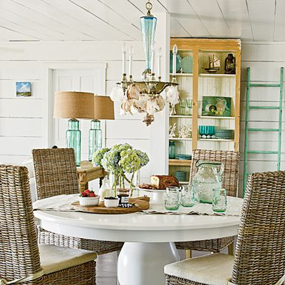 The style of this Bald Head Island, North Carolina, home was directed by one sea-inspired piece in particular: a glass-and-seashell chandelier the homeowner had specially made by artist Louise Gaskill.  coastalliving.com