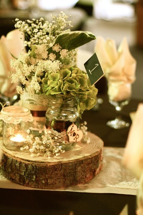 Wood log centerpieces for weddings