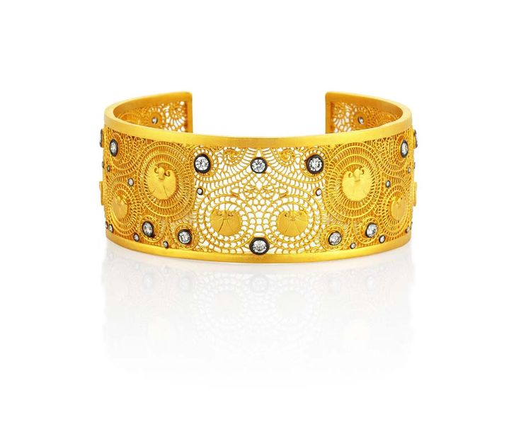 Agape gold cuff from Pinar Oner Design with diamonds. See more: http://www.thejewelleryeditor.com/2014/10/pinar-oner-jewelry-turkish-delight/ #jewellery #jewelry