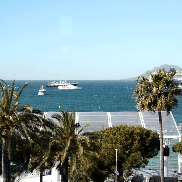 BREEZY VISTA | A cinematic seaside scene, a window's horizon view, captured from the ELIE SAAB third floor Suite.