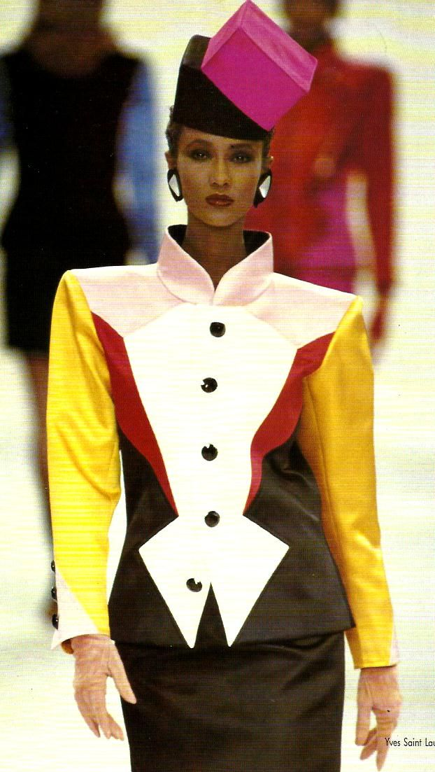 Yves Saint Laurent was a huge designer in the 1980s. He started in the 50s  where he was hea designer for the House of Dior. In 1983, he was the first fashion designer given a solo exhibit by the Metropolitan Museum of Art. He was known for introducing the tuxedo suit for women. In this picture, Iman walked for his fashion show in 1989.