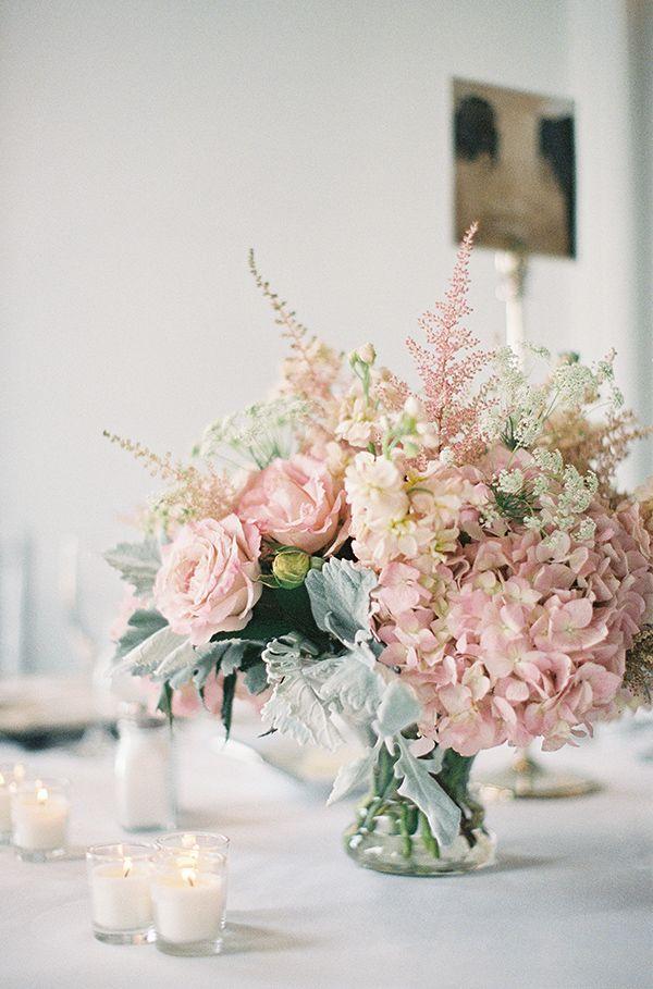 Centerpieces: pedestal mercury vase, pink astilbe, feather plume, blush stock, hydrangea, dusty miller, milky way roses, garden roses.