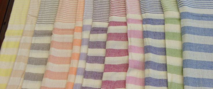 A spring rainbow of colours at Jennifer's Hamam.  #pastels #towels #handloom #weaving #Turkey #Istanbul #pestamel #peştemal #jennifershamam