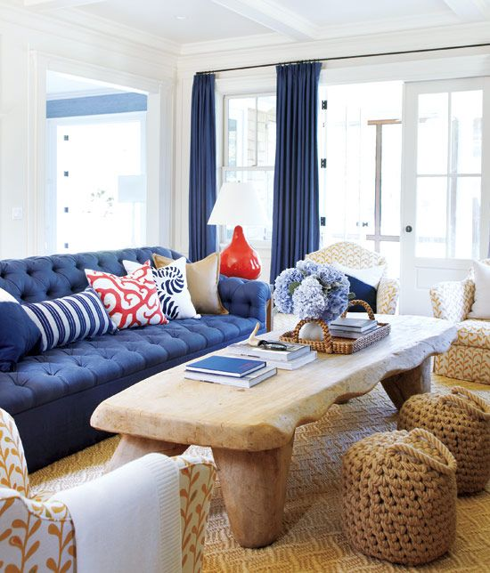 This Coastal Living Room Is Framed With Navy Draperies And Anchored A Sofa The Filled Red White Blue Pillows