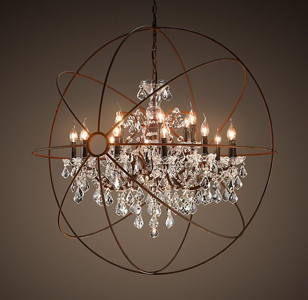 the most amazing light fixture. ever. industrial looking globe surrounds chandelier.