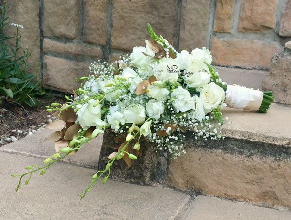 Cascading bridal bouquet in whtie and gold. Floral Design  & flower colouring by www.pinkenergyfloraldesign.co.za