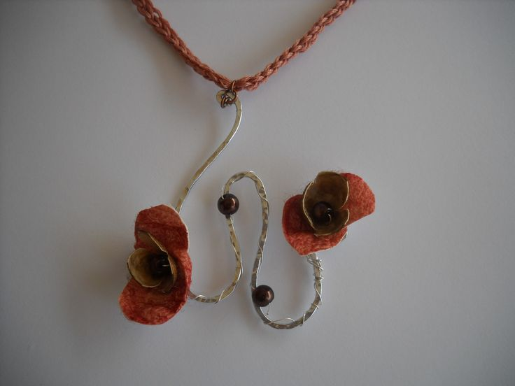 handmade necklace with aluminium wire and silk cocoons.
