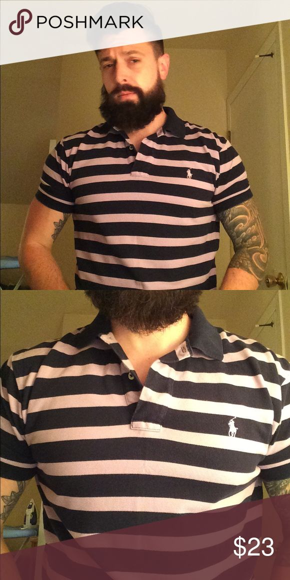 "Polo Ralph Lauren polo shirt Polo Ralph Lauren polo shirt. Size Medium. Navy blue and purple stripes with purple Polo logo. Worn and washed a few times. Great condition. 100% authentic. Smoke free home/non-smoker. Retail $70+. For fitting purposes, as seen in photos, I'm 5'10"" and 170 pounds. Be sure to check out my other listings! Polo by Ralph Lauren Shirts Polos"