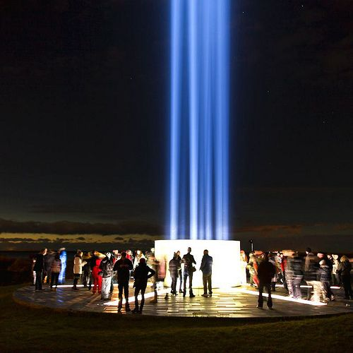 The Imagine Peace Tower, a memorial to assassinated musician and peace activist John Lennon from his widow the artist and singer Yoko Ono, Viðey Island, Reykjavik, Iceland, 2012, photograph by Ragnar Sigurdsson.