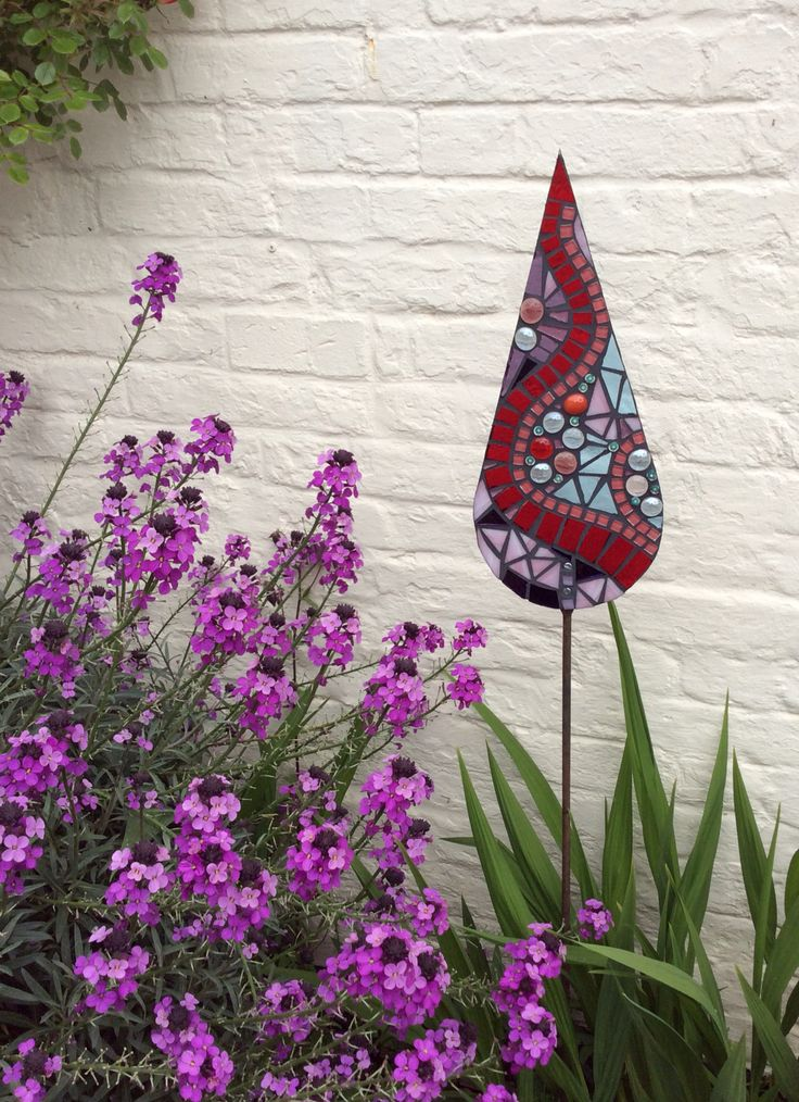 Hand crafted glass garden mosaics- red & pink serpentine collection. This sculpture has been SOLD and is happily adorning an Essex garden!  To order something similar, please contact me.