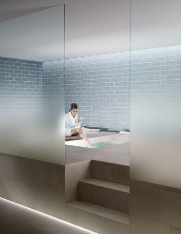 Nuvola clear glass partition wall with progressive satin finish for privacy by Italian glass company Vitrealspecchi.