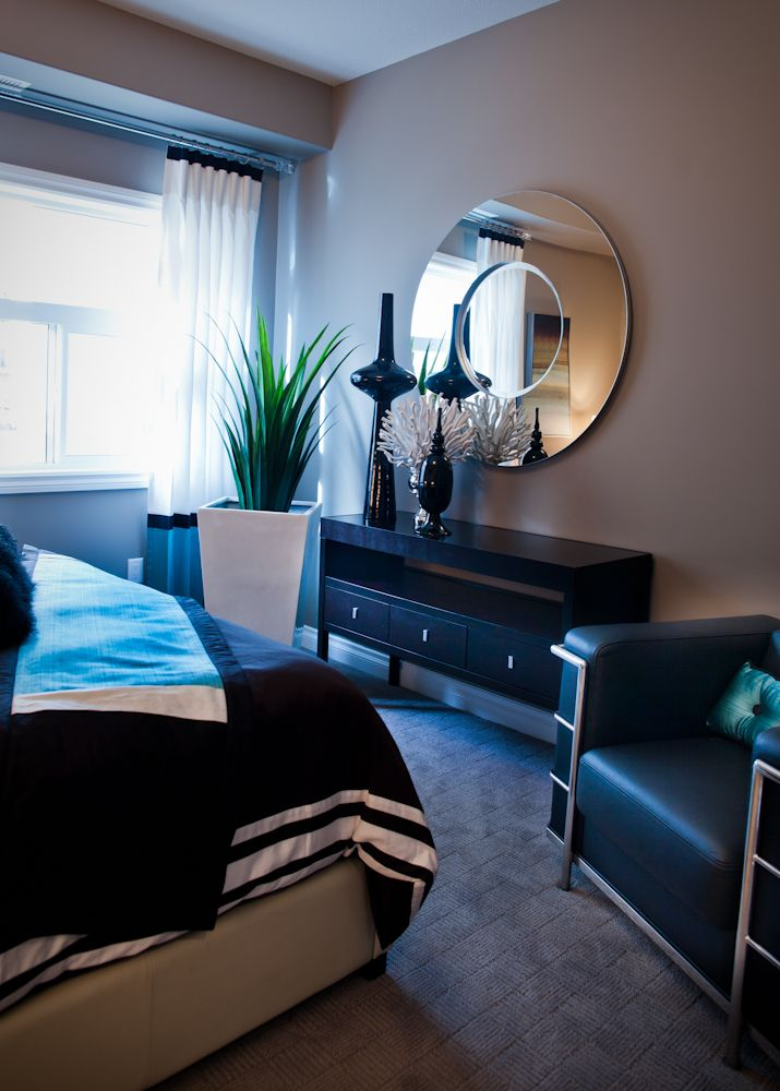 When thinking about the decor of a space, think about what you want to be the focal point, or wow factor.  This mirror is truly a show stopping piece in this bedroom. Its all about scale and having something unique and different in the space. By pairing tall vases with the mirror it helps it to be tied in with the color palette, opposed to looking out of place.