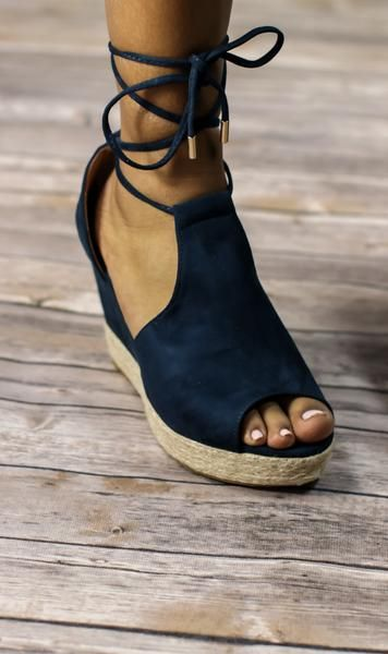 We love these wedges. They are a navy suede open toe lace around wedge with an espadrille half sole. These are perfect for dresses, jeans and even shorts.