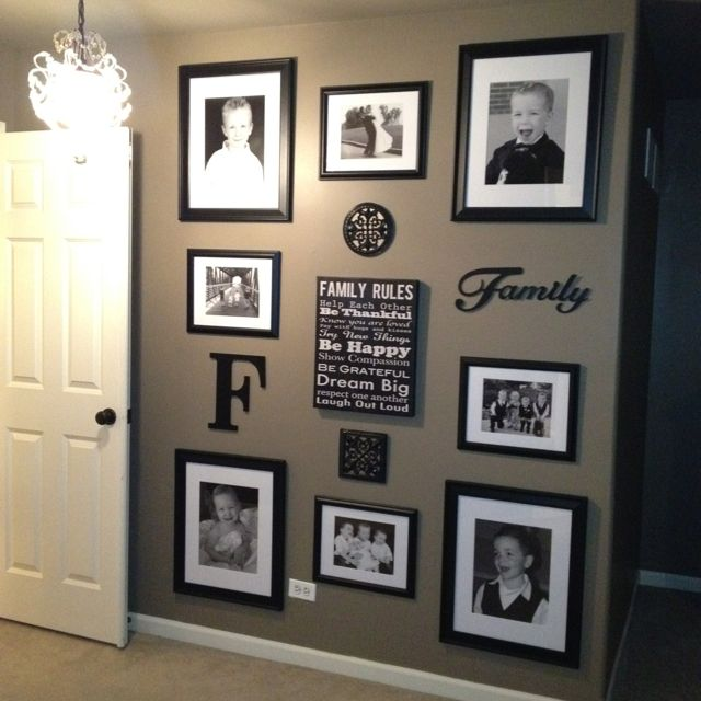 LOVE this photo wall! I'm thinking about doing something similar to a wall as we…
