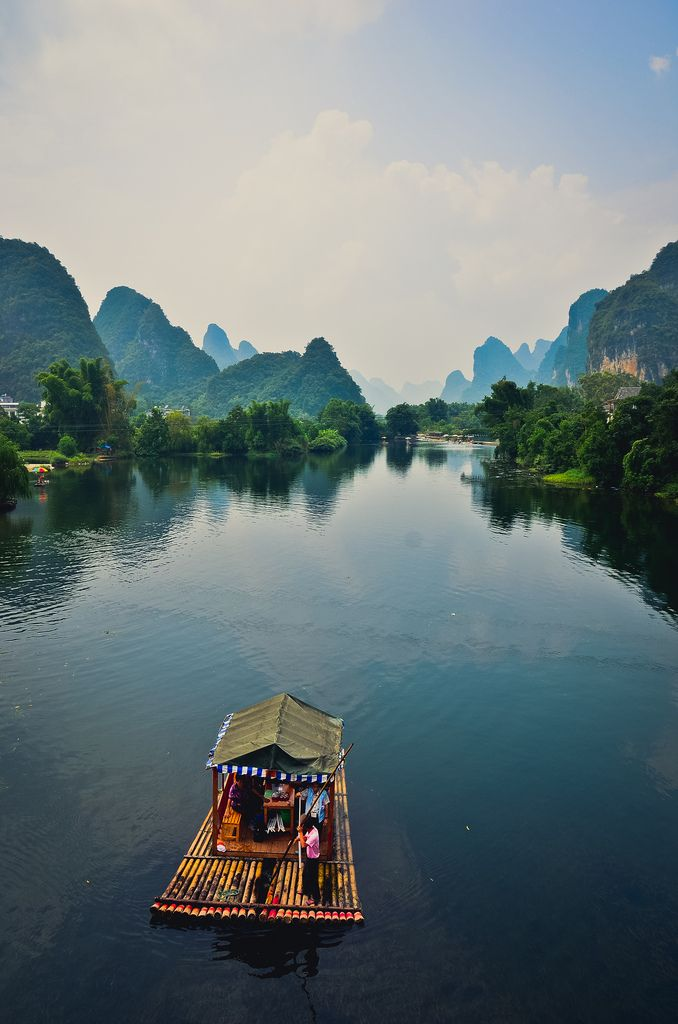 Yangshuo County is a county in Guilin, Guangxi Province, China. Its seat is located in Yangshuo Town. Surrounded by karst peaks and bordered on one side by the Li River it is easily accessible by bus or by boat from nearby Guilin. In the 1980s, the town became popular with foreign backpackers, and by the late 1990s packaged tourists began arriving in greater numbers.