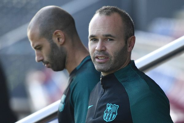 Andres Iniesta of Barcelona and Javier Mascherano of Barcelona look on during the FC Barcelona training session at Ciutat Esportiva Joan Gamper on October 18, 2016 in Barcelona, Catalonia.