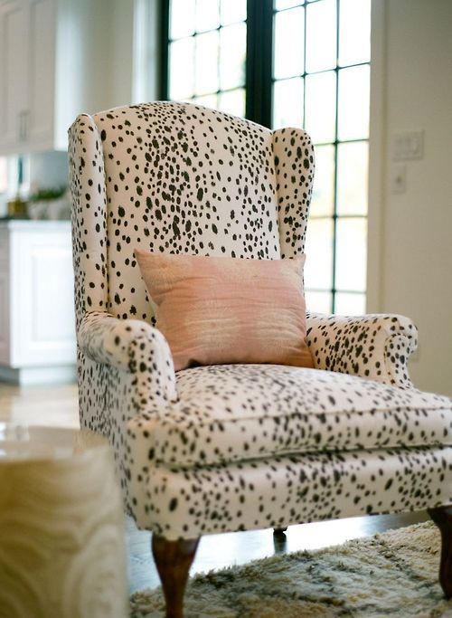 Black and white spotted chair with a baby pink pillow (no Dalmatians were harmed in the making of this chair!)