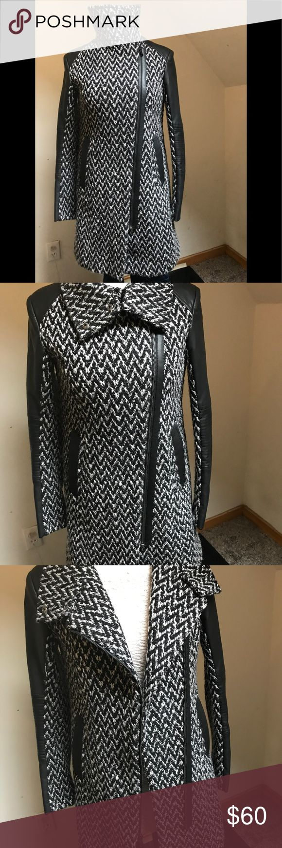 Andrew Marc/ MARC NEW YORK asymmetrical coat. Andrew Marc/ MARC NEW YORK asymmetrical zipper  coat.  Fully lined with 2 side pockets . Black Faux leather trim . Hits above the knee.  Barely worn & in excellent condition. Color is black & white in  chevron tweed pattern. Andrew Marc Jackets & Coats