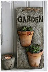 gotta try... What a great idea to set pots in concrete.