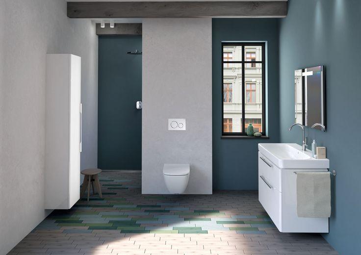 Cette salle de bains réussit la combinaison parfaite entre le moderne et le traditionnel. Un mobilier élégant et contemporain se mélange à un carrelage classique, et des murs aux couleurs assorties.