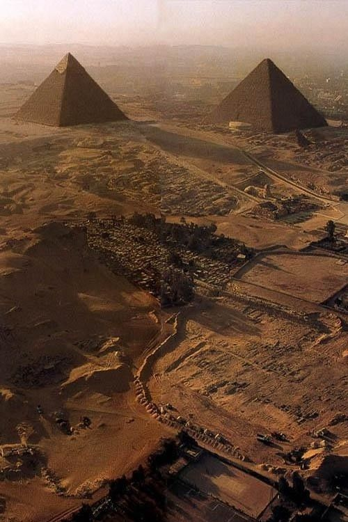 Aerial view of the Chephren (Khafre) & Cheops (Khufu) pyramids, Giza Plateau, Egypt.  Look closely and you will see the Subterranean Boat Pit enclosure which  houses Khufu's Solar Boat.