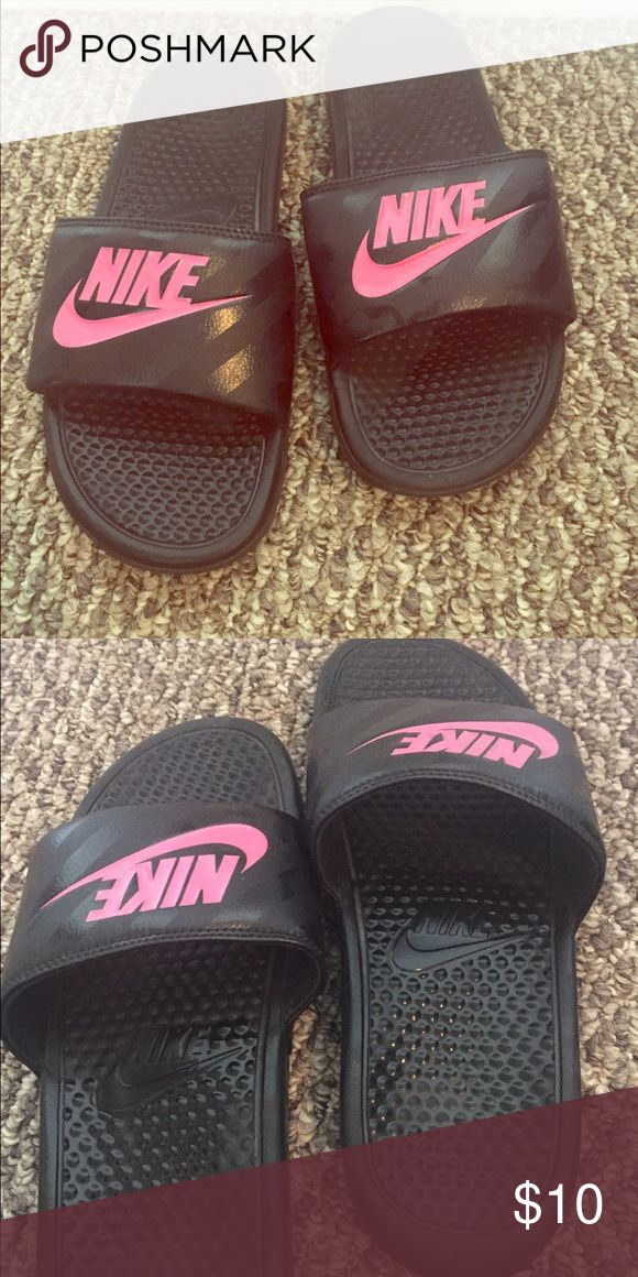 """Nike Sandals Black slip on Nike sandals with """"Nike"""" in hot pink. Sandals in great condition worn twice Nike Shoes Sandals"""