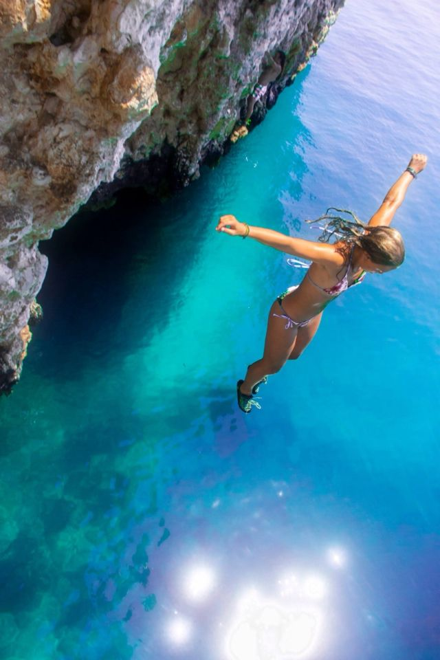 Teenage girl diving accident cliff