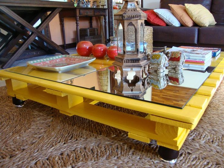 Coffee table made from a wood pallet...love the bright yellow and use of mirror tiles for the top