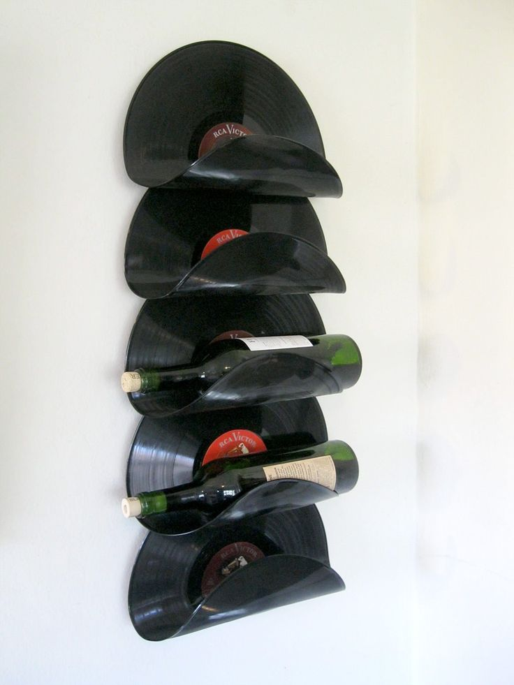 This is my prototype for a wall-hung wine rack made from old vinyl records. The records appear to float with …