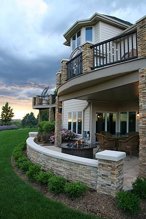 I like this curved lower patio.  We would like to have concrete poured along the whole back of the house.  I like how this patio extends past the upper deck a bit.  We would like stained and stamped concrete outside.