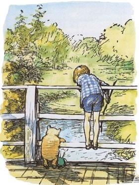 Pooh bear and Christopher Robin playing Pooh sticks