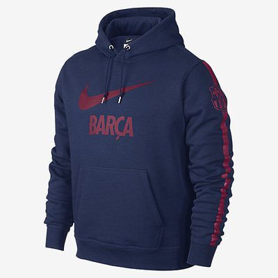 NIKE FC BARCELONA CORE HOODIE Loyal Blue/Red LOYAL LOOK WITH A SOFT FEEL The FC Barcelona Club Core Men's Hoodie features team graphics on a soft cotton blend for unmistakable pride and warm comfort.