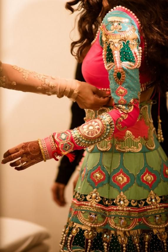 Bridal Deyails - Neon Green and Pink Lehenga with Zari work and Mirror work | WedMeGood  #wedmegood #bridal #details