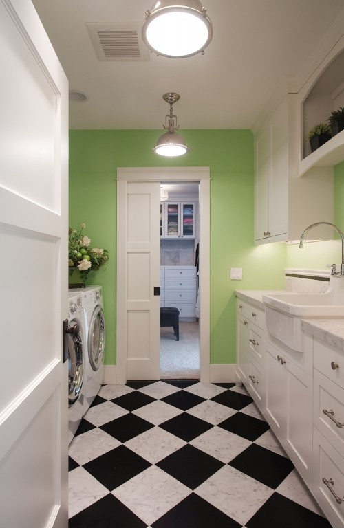 Cute laundry room. Add some either cabinets to the top or a rod and raise the W/D to have hampers underneath.