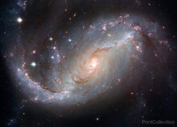 This NASA Hubble Space Telescope view of the nearby barred spiral galaxy NGC 1672 unveils details in the galaxy's star-forming clouds and dark bands of interstellar dust. NGC 1672 is more than 60 mill