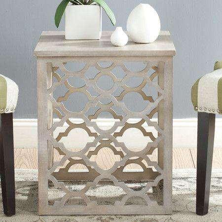 If you prefer traditional furniture and have a living room done in the antique or traditional style, the Safavieh Lonny End Table is made especially for y...