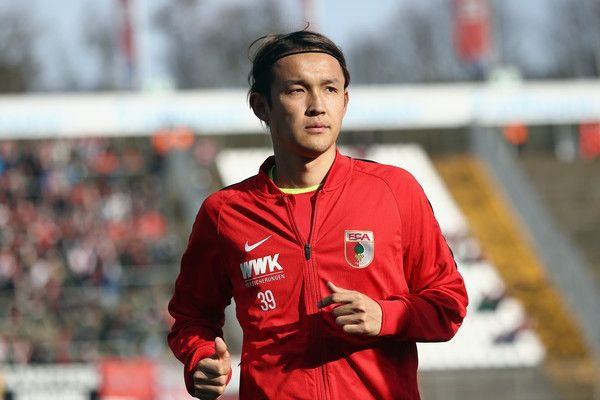 Takashi Usami of Augsburg warms up prior to the Bundesliga match between SV Darmstadt 98 and FC Augsburg at Jonathan-Heimes-Stadion am Boellenfalltor on February 25, 2017 in Darmstadt, Germany.