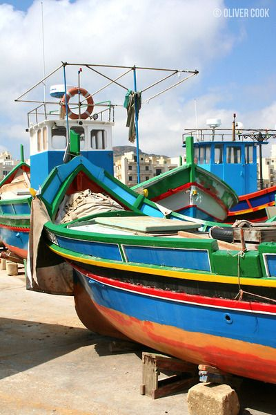 Traditional, brightly painted fishing boats at Marsalforn, Gozo, Malta. © Oliver Cook