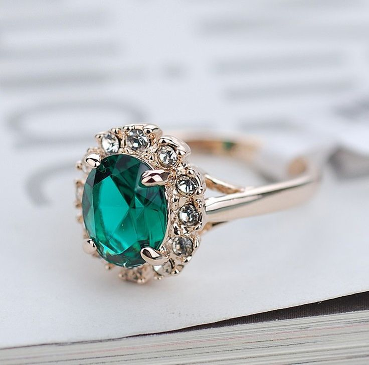 18K Gold Plated Green Stone Ring Italina  A stunning, fashionable ring that makes you the center of attention! Save big on this real gold plated ring! We're marking this down so that you can save HUGE!