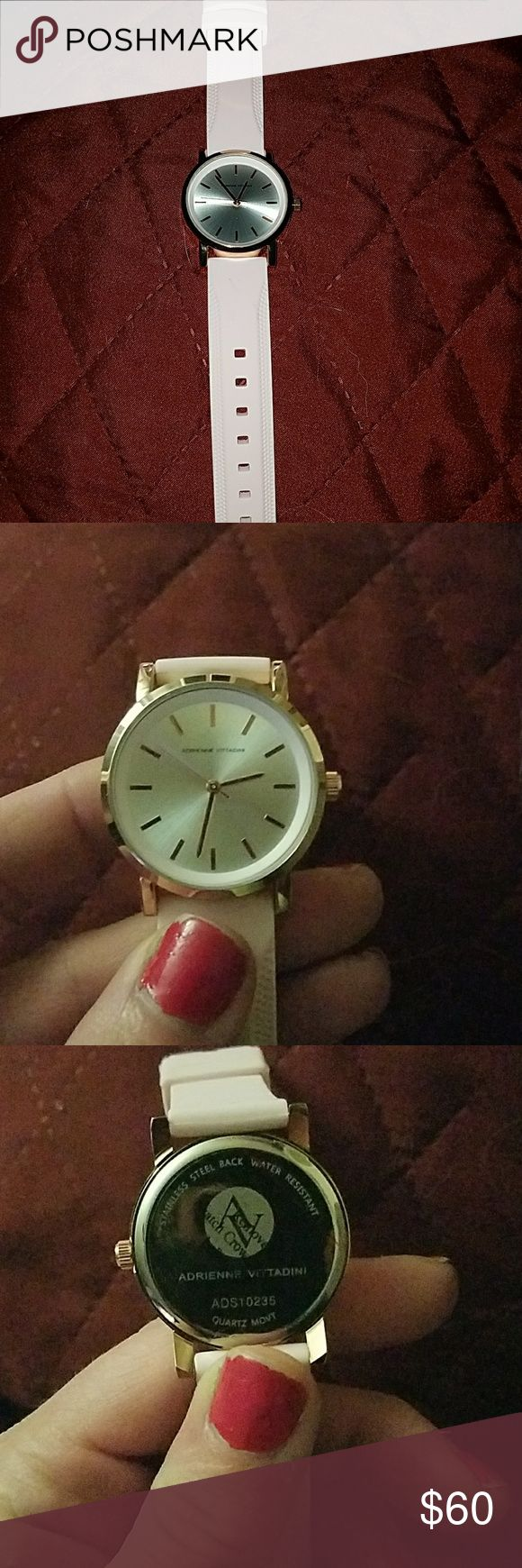 Super nice Adrienne Vittadini brand new watch. Really pretty watch by Adrienne Vittadini new watch. Pink rubbed band, with a silver face, and gold trim. Adrienne Vittadini Accessories Watches