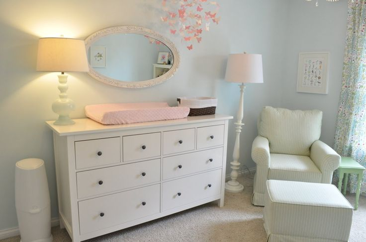 I like the layout. Diaper disposer on the left and a chair in the corner by the window. Crib across the room.