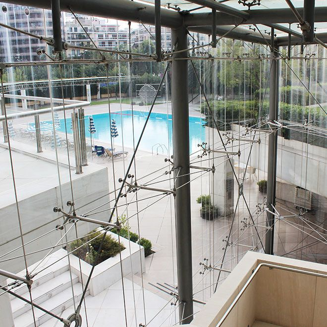 Hilton Hotel Facade Tension Rod Spider Glass Walls Glasscon Jpg