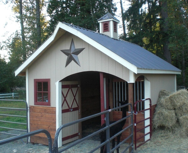 Cute, one horse barn with tack room and covered tacking space.