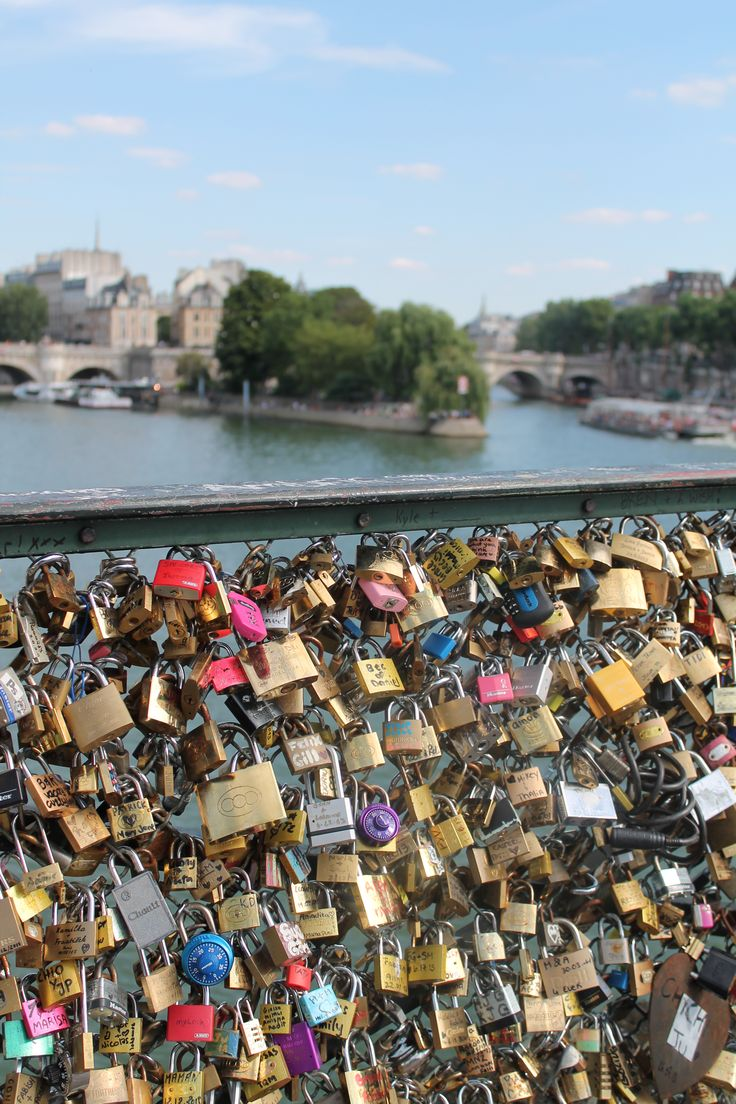 Paris bridge with locks - couples place lock on bridge to symbolize their commitment to each other.