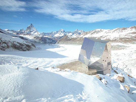 overlooking the Matterhorn, daylight view of The Solar-Powered Swiss Alpine Club's new Monte Rosa Mountaineer's Hut, which resides at 2,810 meters above sea level, was designed by the Department of Architecture at the Swiss Federal Technical University in Zurich (ETH)
