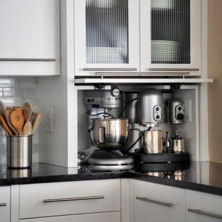 Hide appliances behind door capitol design corner for Kitchen units in garage